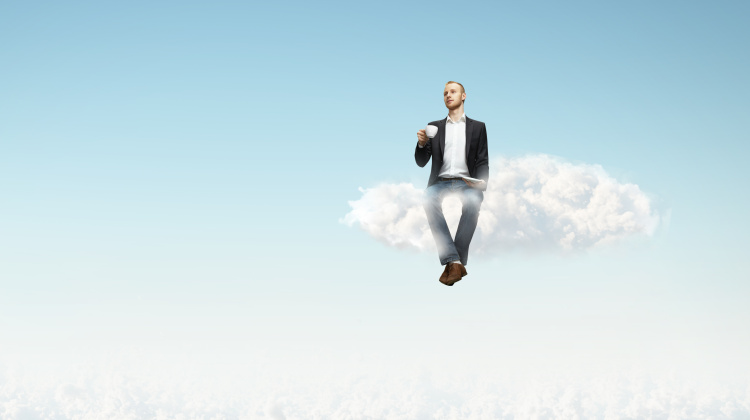 man sitting on a cloud with cup of coffee